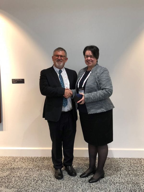 Elizabeth Salisbury the Vincent McGovern Award recipient for 2018 being congratulated by IAP President Peter Bethwaite