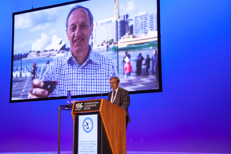 Anthony Gill accepting Distinguished Pathology award on behalf of Robert Eckstein