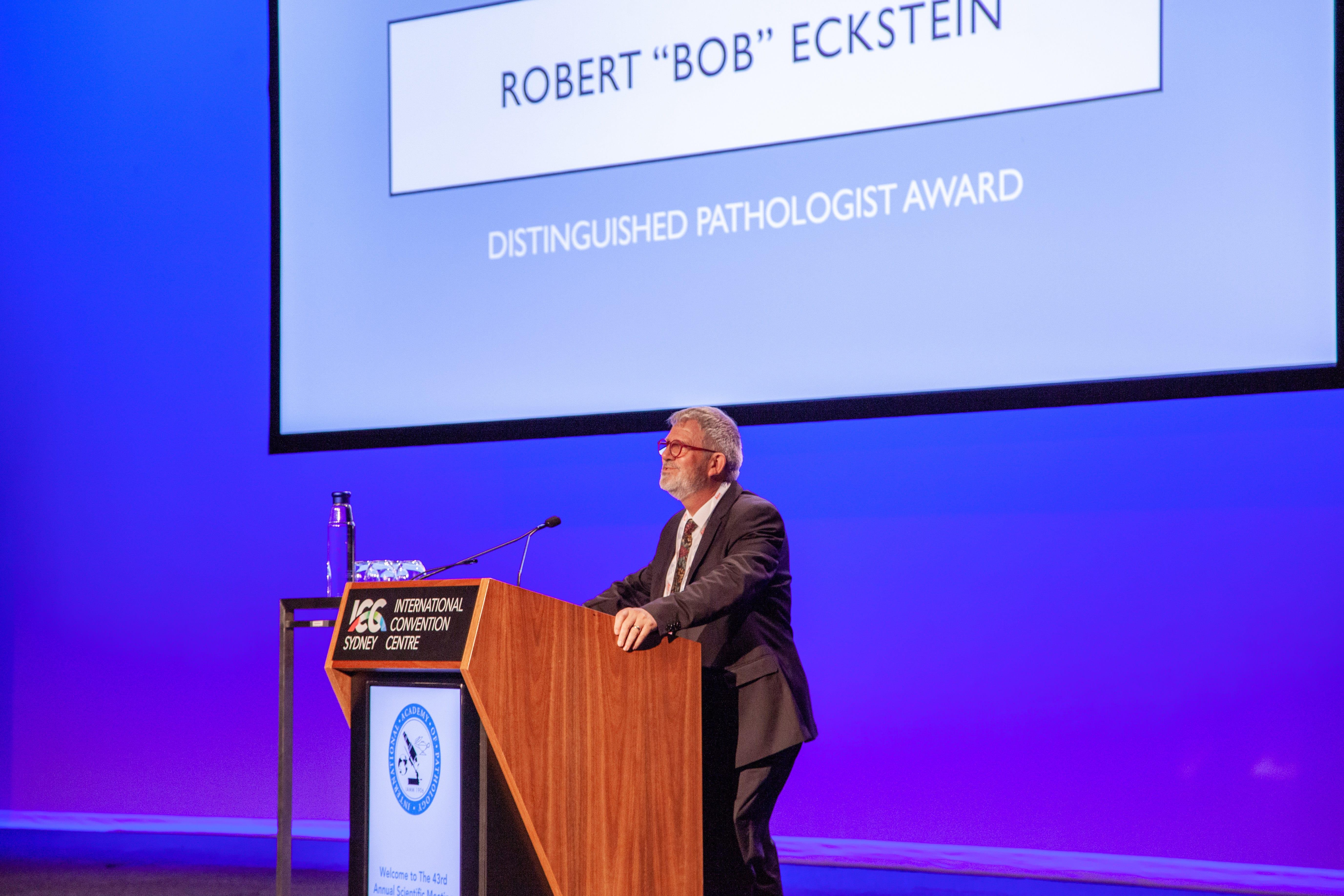 Peter Bethwait annoucing the Distinguished Pathologist award