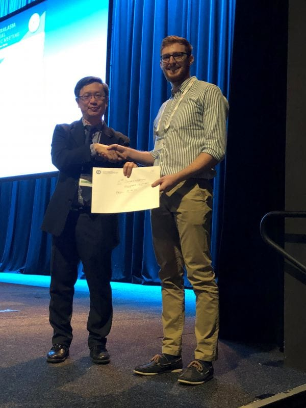 Alfred Lam presenting 2nd Commendation Prize Winner in Abstract Poster Registrar Category to Paul O'Neill