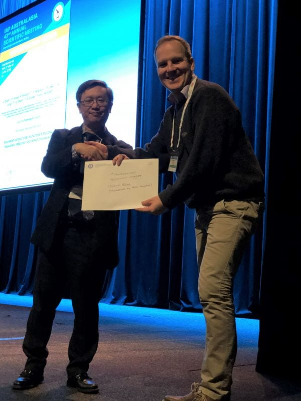 Alfred Lam presenting 1st Commendation Prize Winner in Abstract Poster Pathologist Category to Camelia Quek accepted by Peter Ferguson)